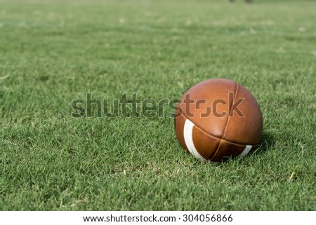Football to the right with green grass background - stock photo