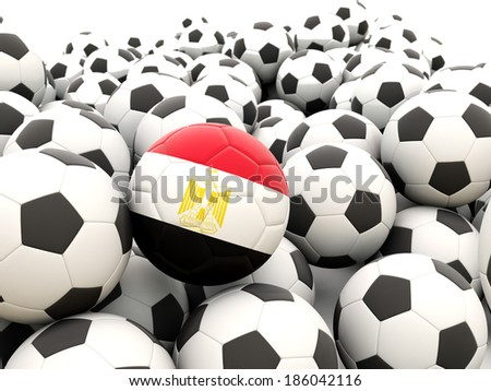 Football with flag of egypt in front of regular balls - stock photo