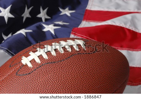 Football with the American Flag in he background - stock photo