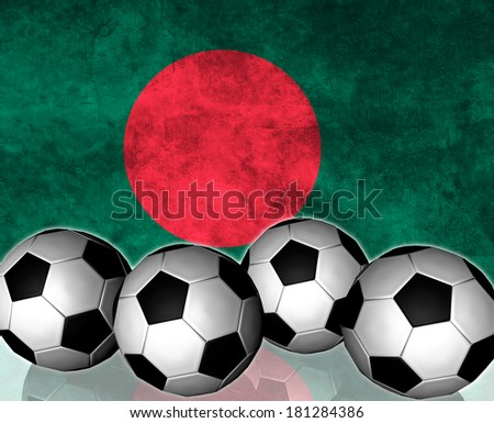 Footballs on top of flag - Bangladesh - stock photo