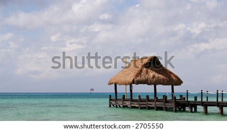 Footbridge and refuge in a caribbean lagoon - stock photo