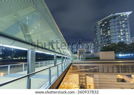 Footbridge in urban city at night - stock photo
