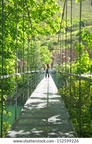 footbridge over Sella river near to Ribadesella village in Asturias Spain - stock photo