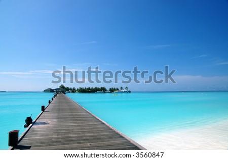 footbridge over turquoise ocean on an maldivian island - stock photo