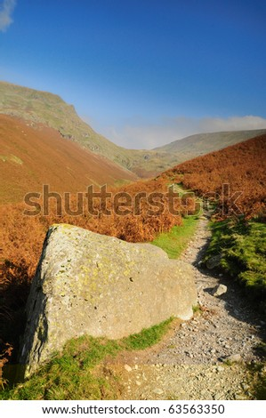 Footpath along Tongue Gill towards Seat Sandal in the English Lake District - stock photo