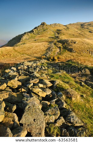 Footpath and rocks on way up to Heron Pike in the English Lake District - stock photo