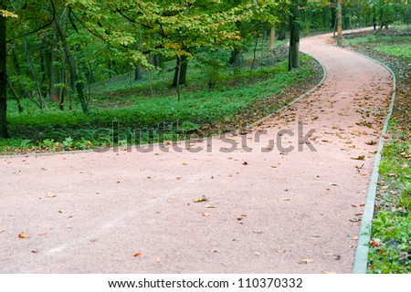 Footpath in autumn park. The Lvov park - stock photo