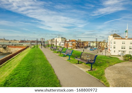 Footpath Lined with Benches in Old Portsmouth, UK - stock photo