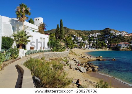 Footpath on the Mediterranean sea coast with beautiful beach and villa, Cala Canyelles Petites, Rosas, Costa Brava, Catalonia, Spain - stock photo