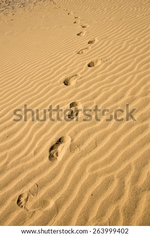 Footprint on sand dune in Maspalomas on Gran Canaria, Canary islands, Spain - stock photo