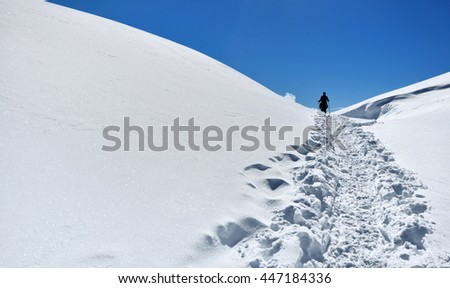 footprint on the snow from a hiker on the top of mountain  - stock photo
