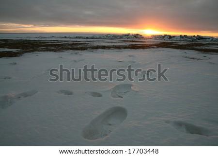 footprint on white snow men go to sun - stock photo