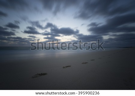 Footprints along the Beach east of Corralejo. Fuerteventura. Long exposure