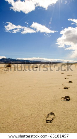 footprints in the sand in the desert of Death Valley