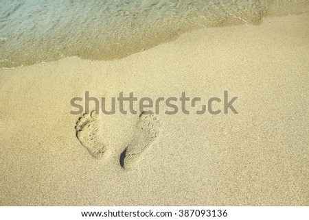 footprints in the sand near the sea