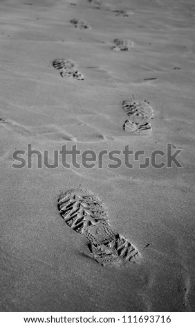 Footprints on sand - stock photo