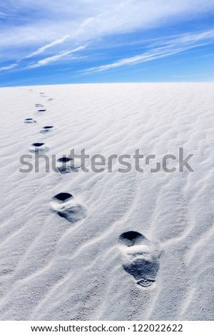 Footprints on sand dunes, White Sands National Monument. - stock photo