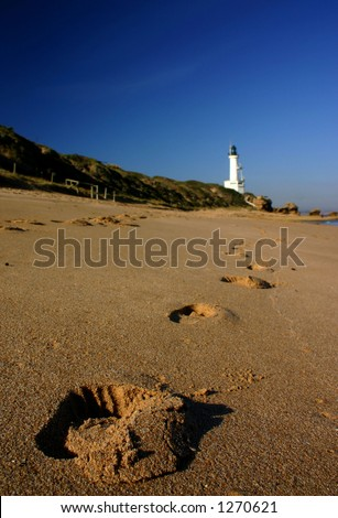 Footprints to the lighthouse - stock photo
