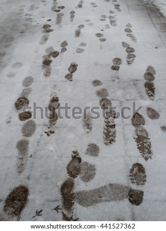 Footprints traces in snow