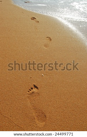 footsteps at the beach - stock photo