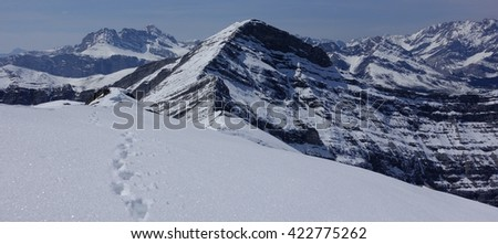 Footsteps on a snow covered mountain