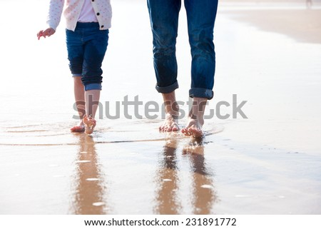 Footsteps on the Beach - stock photo