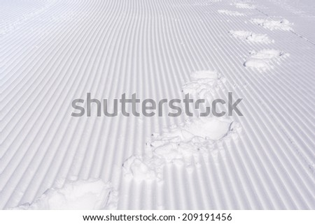 Footsteps on the snow at Falls Creek snow trip Australia - stock photo