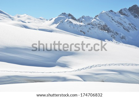 Footsteps on the snow. Melchsee-Frutt, Switzerland - stock photo