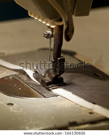 footwear part with zig zag stitching operation - stock photo