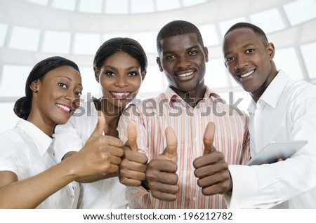 For african business partners / students thumb up, Studio Shot - stock photo