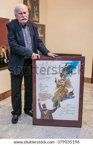"""For editorial use only. Prague, Czech Republic  ?? January 27 2016. Czech artist and illustrator Adolf Born with his painting in theater """"Bez zabradli"""". - stock photo"""