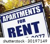 For rent sign in front of apartment building. - stock photo
