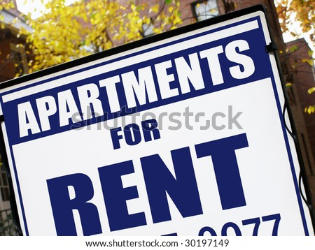 For rent sign in front of apartment building.