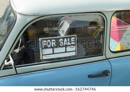 for sale sign on a car - stock photo