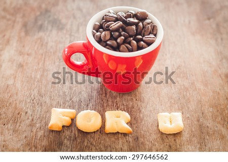 For u alphabet biscuit with red coffee cup, stock photo - stock photo
