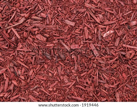 For use as a texture or background image - Red mulch (ground up trees) is used in flower gardens to prevent weeds and barn yards to prevent mud. - stock photo