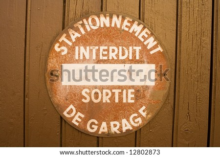 Forbidden sign at the door of a garage at the south of france)