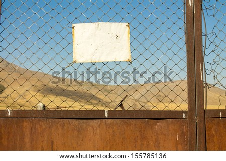Forbidden sign on the chain-link fence - stock photo