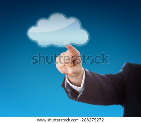 Forearm of a corporate manager pointing at a floating cloud icon. Do place your artwork or copy onto the void cloud symbol! Business metaphor for mobile computing and instant access. Blue background. - stock photo