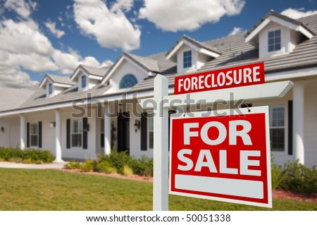 Foreclosure Home For Sale Real Estate Sign in Front of New House - Right Facing. - stock photo