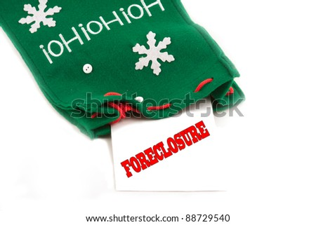 Foreclosure notice for the holidays in christmas sock - stock photo