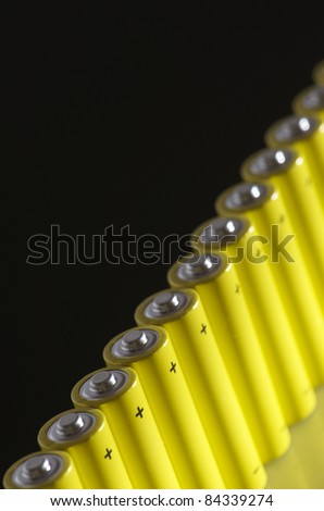 forefront of  a group of AA batteries - stock photo