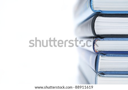 forefront of a group of books stacked - stock photo