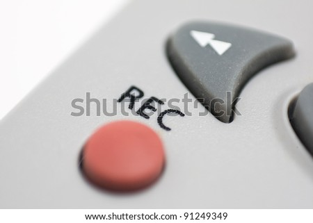 Forefront of an REC button remote control tv on a white background