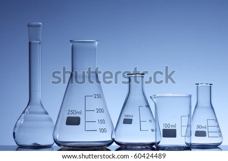 forefront of some empty flasks for laboratory measurement of liquids - stock photo