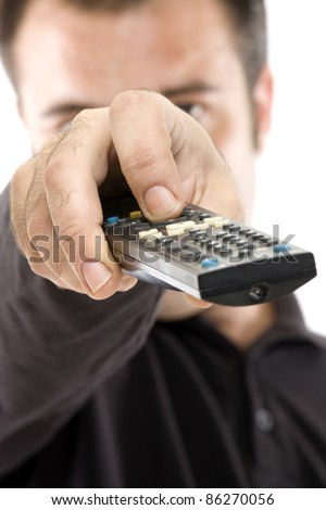 forefront of the hand of a young boy changing the TV channel - stock photo