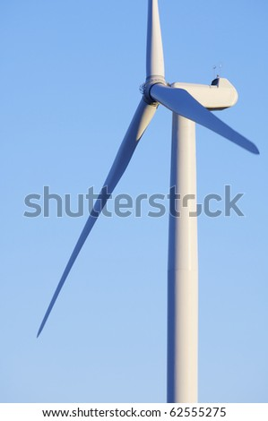 foreground at sunset of a mill for production of renewable electrical energy - stock photo