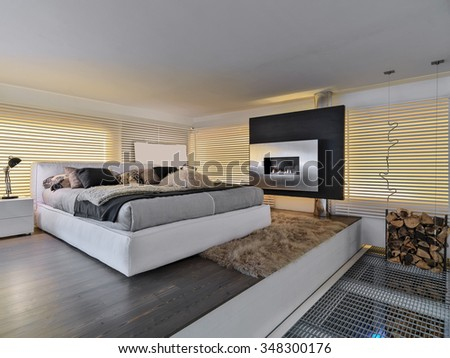 foreground of a modern bedroom with a fireplace Bioethanol - stock photo