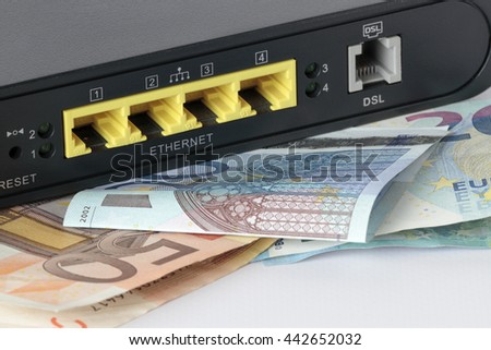 foreground of the back of a router with some euro bills