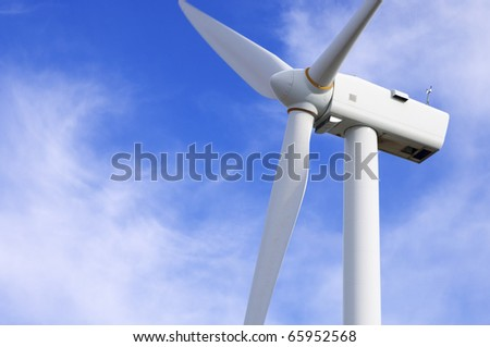 foreground of the top of a modern windmill - stock photo